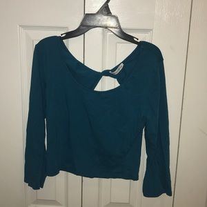 Blue long sleeve crop top. With twist in the back